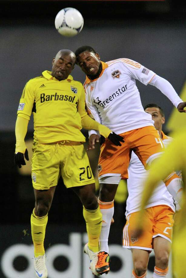 Emilio Renteria #20 of the Columbus Crew and Jermaine Taylor #4 of the Houston Dynamo battle for control of the ball in the first half on April 21, 2012 at Crew Stadium in Columbus, Ohio. Photo: Jamie Sabau, Getty Images / 2012 Getty Images