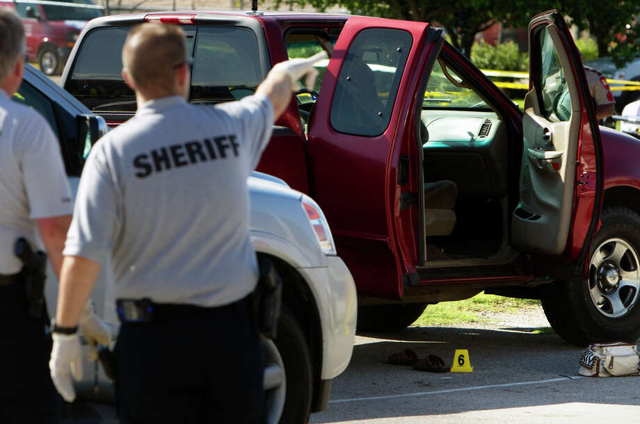 Montgomery County officials investigate the scene of the fatal shooting Tuesday of Kala Golden Schuchardt and the kidnapping of her 3-day-old son, Keegan. Photo: Cody Duty / © 2011 Houston Chronicle