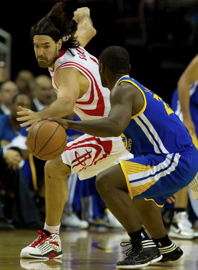Luis Scola (4) of the Houston Rockets tries to steal the ball from Charles Jenkins (22) of the Golden State Warriors on Saturday, April 21, 2012, in Houston, Texas. (George Bridges/MCT) Photo: George Bridges, McClatchy-Tribune News Service / MCT