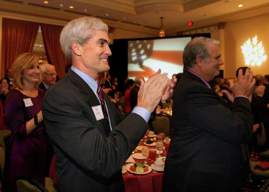 GOP candidate Mike Anderson, center, wants to run what he says will be a more stable DA's office. Photo: Cody Duty / © 2011 Houston Chronicle