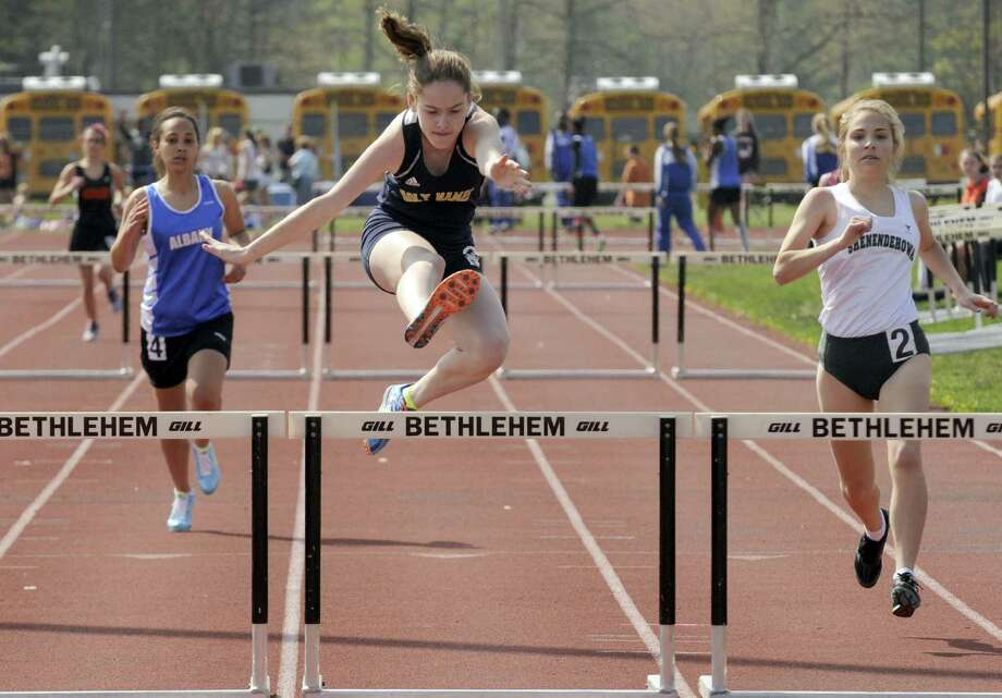 Holy Names Julia Smith, center,wins a heat in the 300 hurdles during the The Lady Eagles Invitational  girls high school track meet in Delmar N.Y. Saturday April 21, 2012. (Michael P. Farrell/Times Union) Photo: Michael P. Farrell