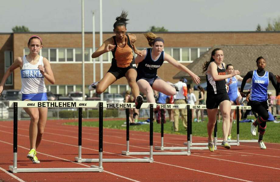 Girls compete in the 300 hurdles during the The Lady Eagles Invitational girls high school track meet in Delmar N.Y. Saturday April 21, 2012. (Michael P. Farrell/Times Union) Photo: Michael P. Farrell