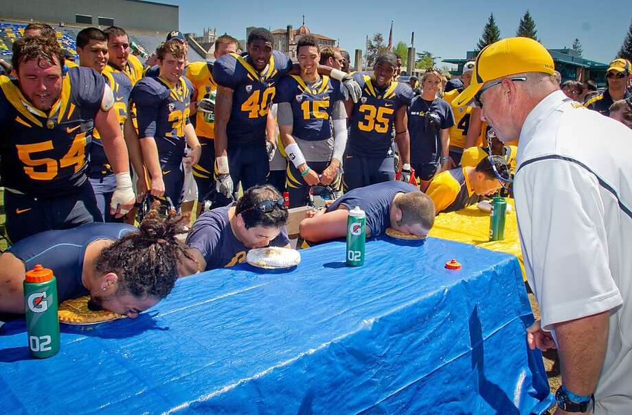 The competition continues after the game at Edwards Stadium with a pie-eating contest among players. Photo: John Storey, Special To The Chronicle