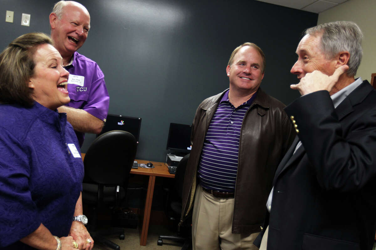 Alumni Cindy Dwyer Buschman and Guy Bob Buschman, left, both class of '73, and Steve Taylor, class of '71, right, speak with head football coach Gary Patterson before a TCU boosters luncheon at Polo Fields Golf Center at Brackenridge Park, Thursday, April 19, 2012.