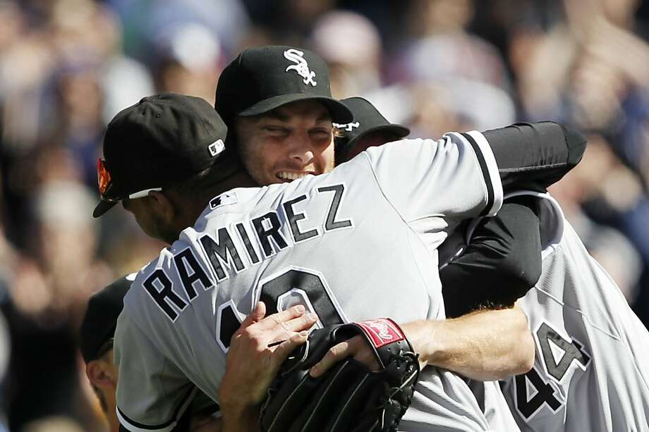 Chicago White Sox starting pitcher Phil Humber, center, is mobbed by teammates after pitching a perfect baseball game against the Seattle Mariners, Saturday, April 21, 2012, in Seattle. The White Sox won 4-0. Photo: Elaine Thompson, Associated Press