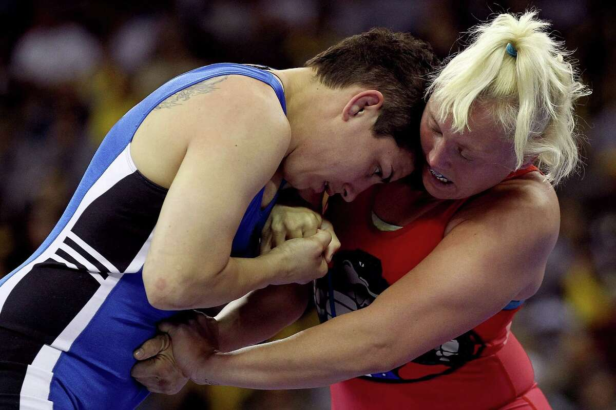 IOWA CITY, IA - APRIL 21: Kristie Davis (red) wrestles Stephany Lee (blue) in the 72 kg freestyle weight class during the challenge tournament for the finals of the US Wrestling Olympic Trials at Carver Hawkeye Arena on April 21, 2012 in Iowa City, Iowa. (Photo by Matthew Stockman/Getty Images)
