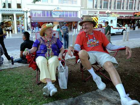 "Andrew and Joanne Zintel, self described ""Winter Texans,"" relax in Alamo Plaza on Saturday, April 21, 2012. They have attended Fiesta each of the last seven years. Billy Calzada / Express-News Photo: BILLY CALZADA, SAN ANTONIO EXPRESS-NEWS / San Antonio Express-News"