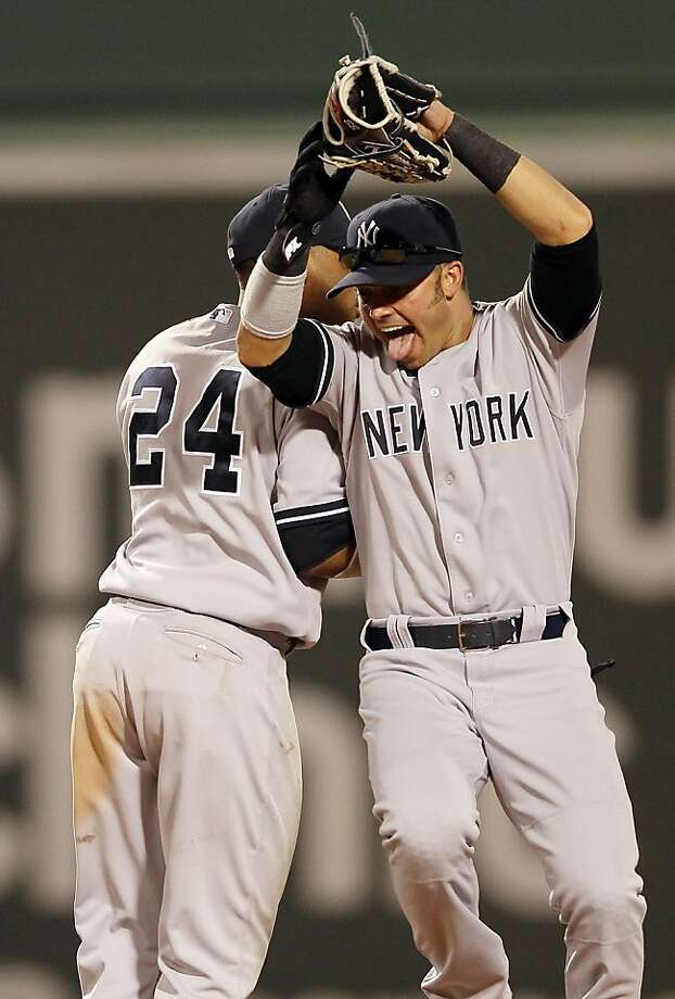 BOSTON, MA - APRIL 21:  Nick Swisher #33 and Robinson Cano #24  of the New York Yankees celebrate the win over the Boston Red Sox on April 21, 2012 at Fenway Park in Boston, Massachusetts. The New York Yankees defeated the Boston Red Sox 15-9.  (Photo by Elsa/Getty Images) Photo: Elsa, Getty Images