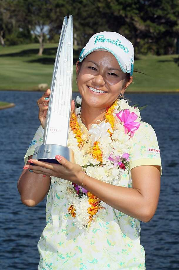 KAPOLEI, HI - APRIL 21:  Ai Miyazato of Japan poses with the trophy after winning the LPGA LOTTE Championship Presented by J Golf at the Ko Olina Golf Club on April 21, 2012 in Kapolei, Hawaii.  (Photo by Jeff Gross/Getty Images) Photo: Jeff Gross, Getty Images
