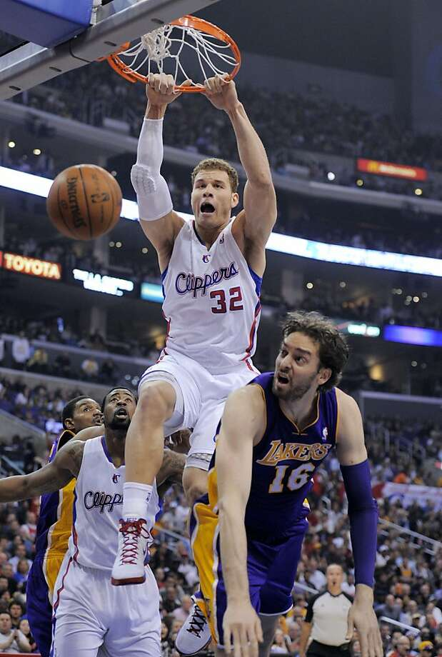 Los Angeles Clippers forward Blake Griffin dunks over Los Angeles Lakers forward Pau Gasol, of Spain, during the first half of an NBA basketball game, Wednesday, April 4, 2012, in Los Angeles. (AP Photo/Mark J. Terrill) Photo: Mark J. Terrill, Associated Press