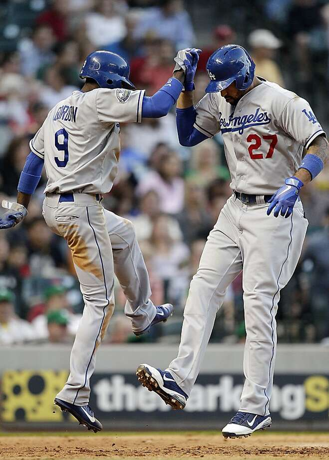 HOUSTON,TX - APRIL 21: Matt Kemp #27 of the Los Angeles Dodgers celebrates with Dee Gordon #9 after hitting a two-run home run in the sixth inning against the Houston Astros on April 21, 2012 at Minute Maid Park in Houston, Texas. (Photo by Bob Levey/Getty Images) Photo: Bob Levey, Getty Images