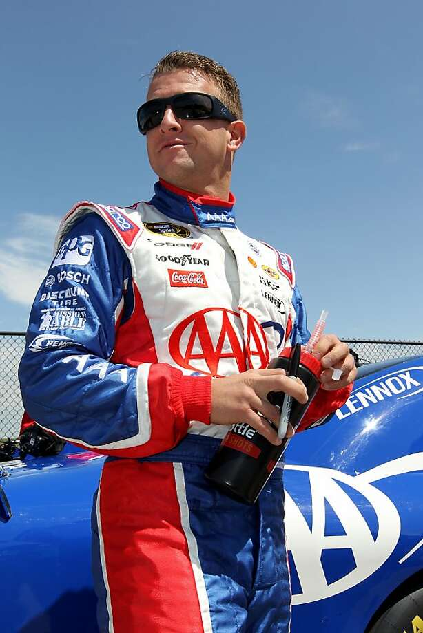 KANSAS CITY, KS - APRIL 21:  AJ Allmendinger, driver of the #22 AAA Dodge, looks on during qualifying for the NASCAR Sprint Cup Series STP 400 at Kansas Speedway on April 21, 2012 in Kansas City, Kansas.  (Photo by Jamie Squire/Getty Images) Photo: Jamie Squire, Getty Images