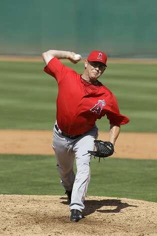 Los Angeles Angels relief pitcher Jason Isringhausen delivers against the Cincinnati Reds in a  spring training baseball game Wednesday, March 28, 2012, in Goodyear, Ariz. (AP Photo/Mark Duncan) Photo: Mark Duncan, Associated Press