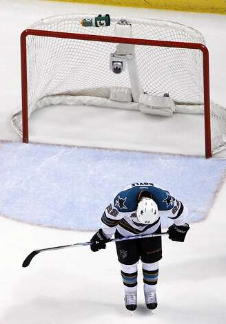 Dan Boyle of the Sharks listens to the final horn eliminating the San Jose team from the Stanley Cup playoffs. Photo: Jeff Roberson, Associated Press