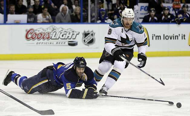 St. Louis Blues' Barret Jackman, left, and San Jose Sharks' Martin Havlat, of the Czech Republic, chase after a loose puck during the first period in Game 5 of an NHL first-round playoff series hockey game on Saturday, April 21, 2012, in St. Louis. Photo: Jeff Roberson, Associated Press