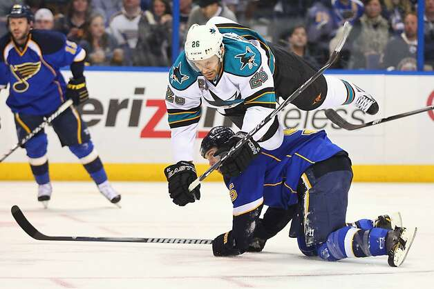 Michal Handzus #26 of the San Jose Sharks trips over Barret Jackman #5 of the St. Louis Blues during Game Five of the Western Conference Quarterfinals during the 2012 NHL Stanley Cup Playoffs at the Scottrade Center on April 21, 2012 in St. Louis, Missouri. Photo: Dilip Vishwanat, Getty Images