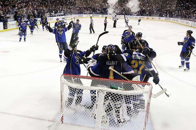 St. Louis Blues players celebrate with goaltender Brian Elliott as time expires against the San Jose Sharks during the third period in Game 5 of an NHL Stanley Cup first-round hockey playoff series, Saturday, April 21, 2012, in St. Louis. The Blues won 3-1 and won the series 4-1. (AP Photo/St. Louis Post-Dispatch, Chris Lee) Photo: Chris Lee, Associated Press