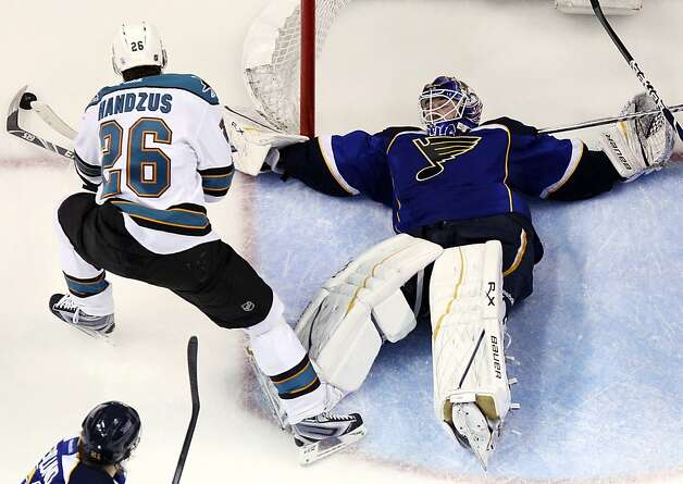 St. Louis Blues goaltender Brian Elliott defends against San Jose Sharks center Michael Handzus during the third period in Game 5 of an NHL Stanley Cup first-round hockey playoff series, Saturday, April 21, 2012, in St. Louis. The Blues won 3-1 and won the series 4-1. (AP Photo/St. Louis Post-Dispatch, Chris Lee) Photo: Chris Lee, Associated Press
