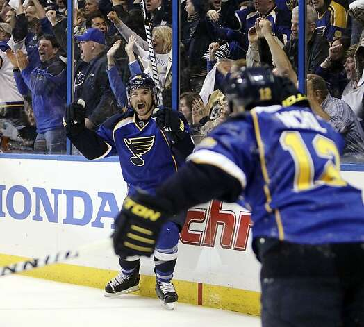 St. Louis Blues right wing Jamie Langenbrunner, left, celebrates after scoring on an assist from Scott Nichol, right, against the San Jose Sharks during the third period in Game 5 of an NHL Stanley Cup first-round hockey playoff series, Saturday, April 21, 2012, in St. Louis. The Blues won 3-1 and won the series 4-1. (AP Photo/St. Louis Post-Dispatch, Chris Lee) Photo: Chris Lee, Associated Press