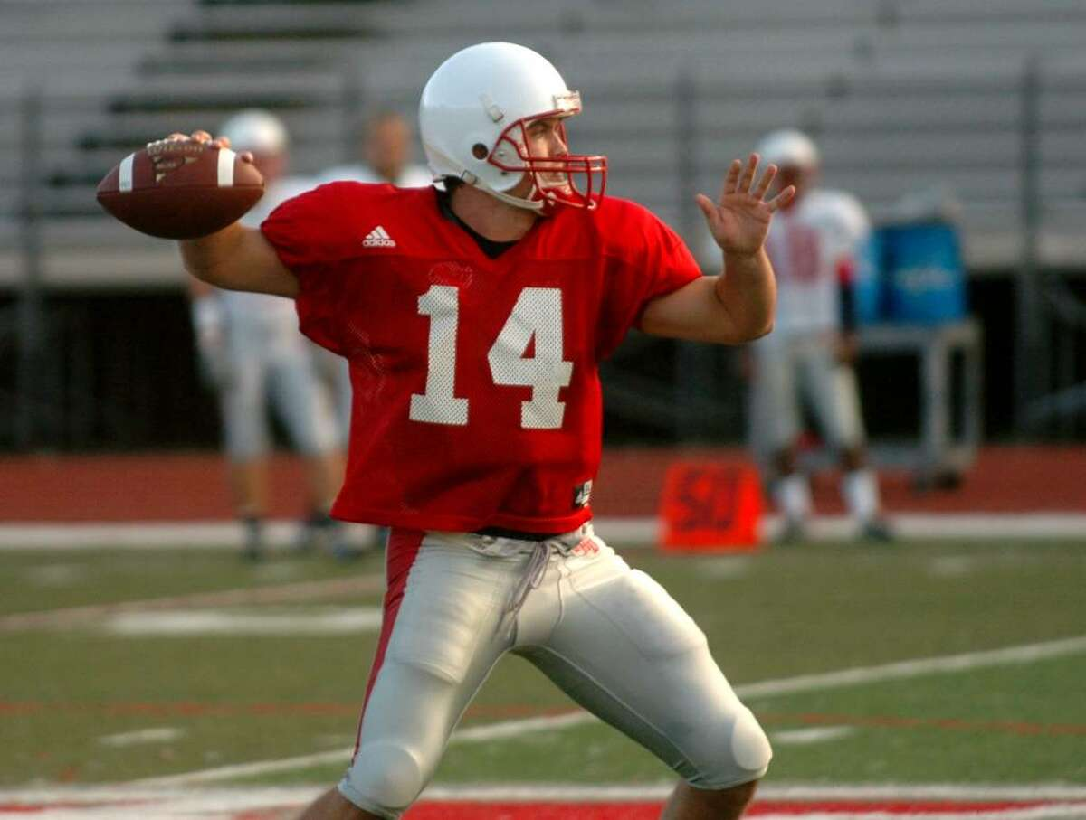 SHU football practice action in Fairfield, CT on Thursday Aug. 27, 2009. Here, QB #14 Dale Fink gets ready to throw a pass during a scrimage.