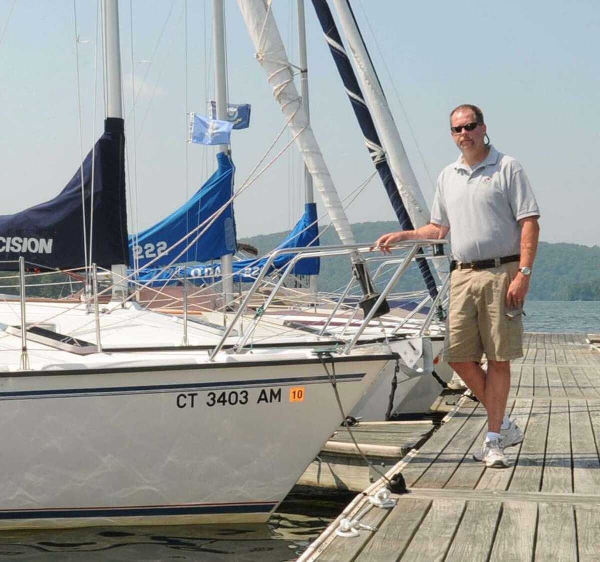 Mitch O'Hara Jr., co-owner of Candlewood East Marina in Brookfield, CT., stand on a dock at the marina on Tuesday August 18, 2009.