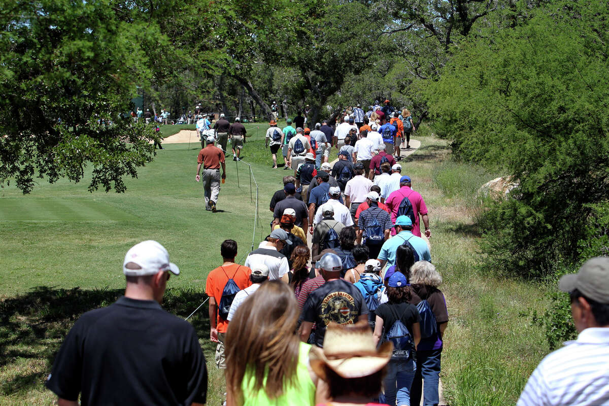 The crowd follow the leaders on the fifth hole during the third round of the 2012 Valero Texas Open on Saturday, April 21, 2012.