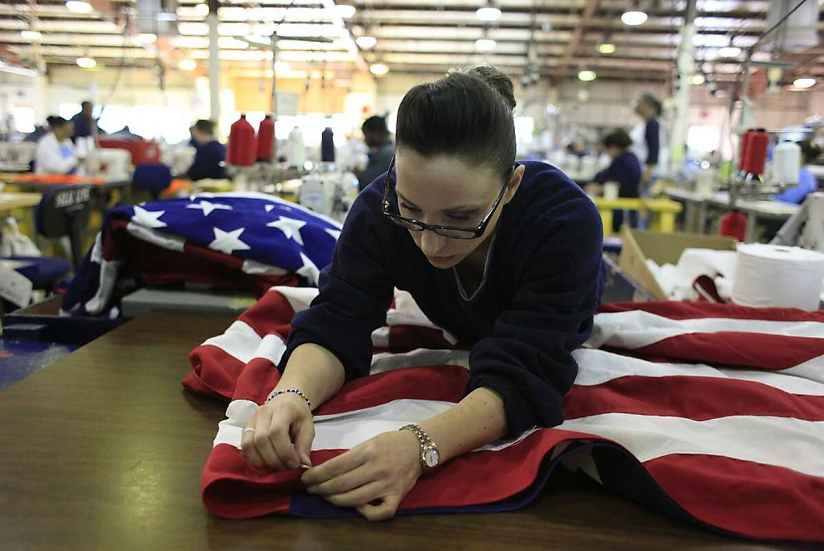 One inmate works on an American flag while working in the Prison Industries Authority Fabrics program at the Central California Women's Facility on Thursday, April 5, 2012 in Chowchilla, Calif.