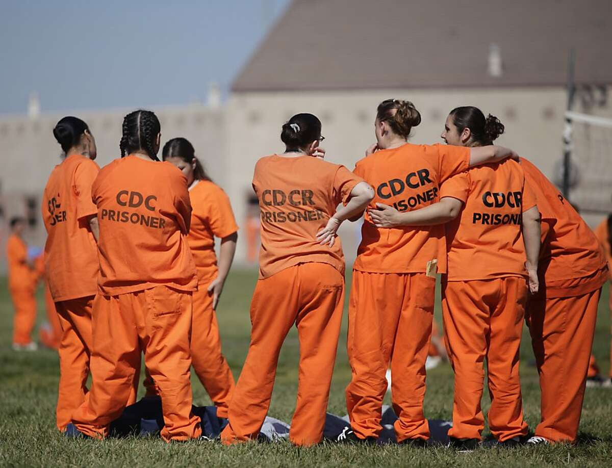 Inmates stand together in a yard at Central California Women's Facility on Thursday, April 5, 2012 in Chowchilla, Calif.