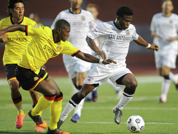 The Scorpions' Walter Ramirez (right) tries to get past Fort Lauderdale's Nickardo Blake (left) during their match on Saturday, April 21, 2012 at Heroes Stadium. Photo: John Albright, For The Express-News