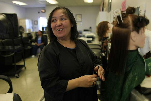 Bianca Cantry of Bakersfield practices cutting hair for the state board exam at Central California Women's Facility  on Thursday, April 5, 2012 in Chowchilla, Calif. Photo: Lea Suzuki, The Chronicle