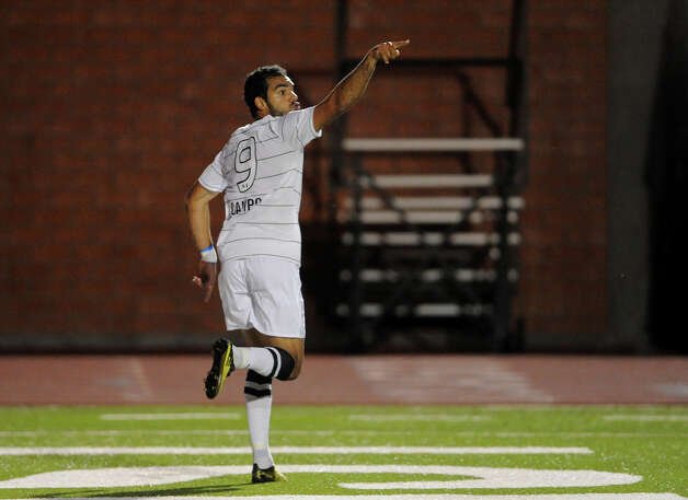 The Scropions' Pablo Campos (9) celebrates after scoring the team's first goal during a match against the Fort Lauderdale Strikers on Saturday, April 21, 2012 at Heroes Stadium. Photo: John Albright, For The Express-News