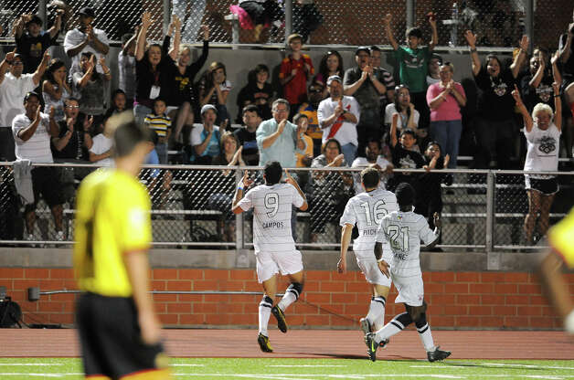 Scorpions fans celebrate after Pablo Campos (9) scored the first goal in team history during a match against the Fort Lauderdale Strikers on Saturday, April 21, 2012 at Heroes Stadium. Photo: John Albright, For The Express-News
