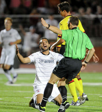 The Scorpions' Pablo Campos pleads for a foul with the referee during a match against the Fort Lauderdale Strikers on Saturday, April 21, 2012 at Heroes Stadium. Photo: John Albright, For The Express-News