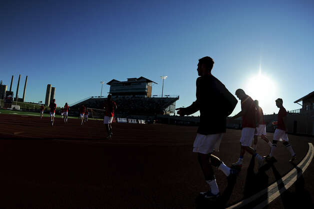Scorpions players jog onto the field late in the afternoon to warm up before their match against the Fort Lauderdale Strikers on Saturday, April 21, 2012 at Heroes Stadium. Photo: John Albright, For The Express-News