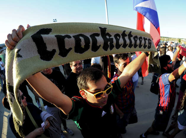 "A member of the soccer fan club ""The Crocketteers"" holds up his scarf as he enters the stadium before a match between the Scorpions and the Fort Lauderdale Strikers on Saturday, April 21, 2012 at Heroes Stadium. Photo: John Albright, For The Express-News"