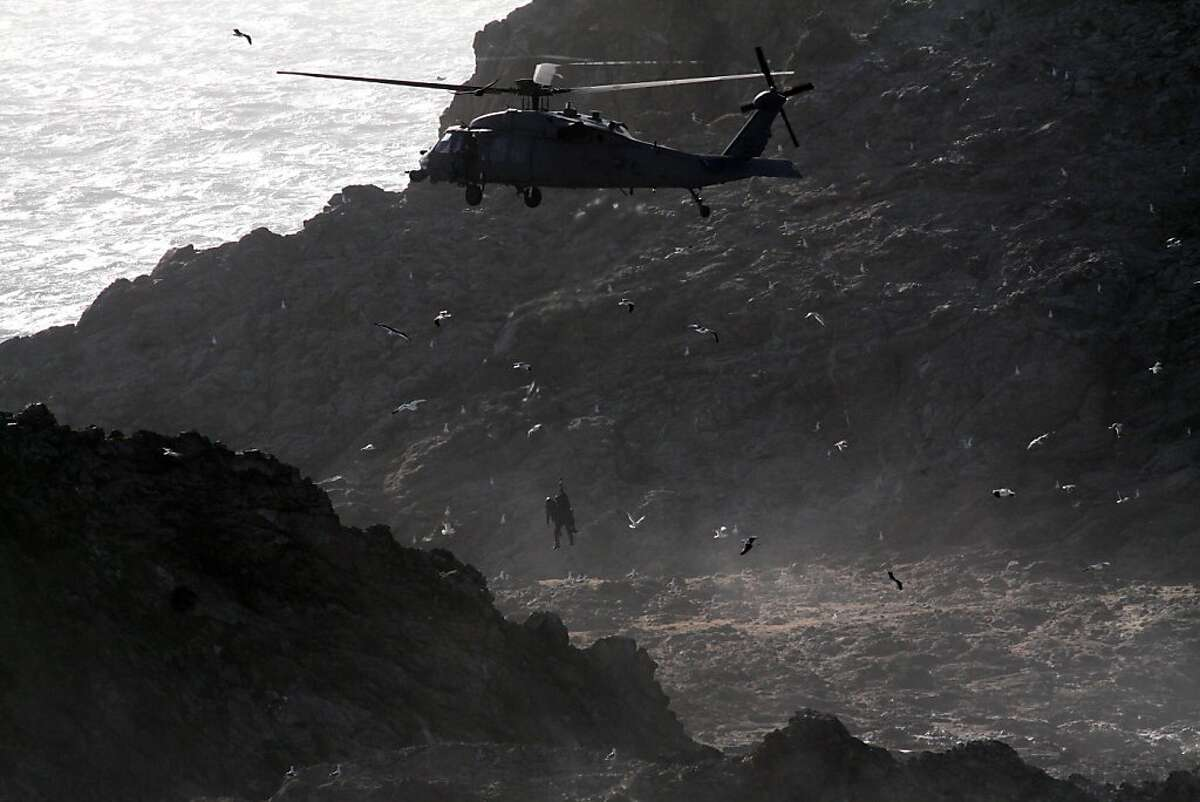 This photo shows Air National guard dropping off personnel to check out the wreck of Low Speed Chase, a 38-foot sailboat from the San Francisco Yacht Club in Belvedere, on Saturday, April 14, after it was slammed broadside by a 12-foot wave as it rounded the Farallones during the Full Crew Farallones Race. Five of eight crew members washed overboard, and the boat crashed into the rocks.