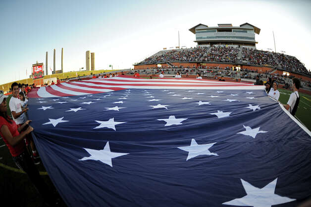 The American flag is presented at center field before a NASL match between the San Antonio Scorpions and the Fort Lauderdale Strikers on Saturday, April 21, 2012 at Heroes Stadium. Photo: John Albright, For The Express-News