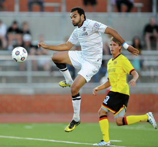 The Scorpions' Pablo Campos (9) leaps as he tries to get off a shot on the goal during a match against the Fort Lauderdale Strikers on Saturday, April 21, 2012 at Heroes Stadium. Photo: John Albright, For The Express-News
