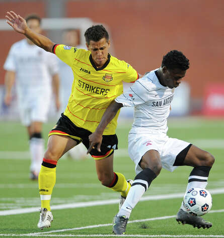 The Scorpions' Walter Ramirez (right) tries to work the ball around Fort Lauderdale's Loepoldo Morales (left) during a match on Saturday, April 21, 2012 at Heroes Stadium. Photo: John Albright, For The Express-News