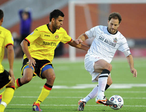 The Scorpions' Kevin Harmse (right) tries to work the ball around Fort Lauderdale's Aly Hassan (left) during a match on Saturday, April 21, 2012 at Heroes Stadium. Photo: John Albright, For The Express-News