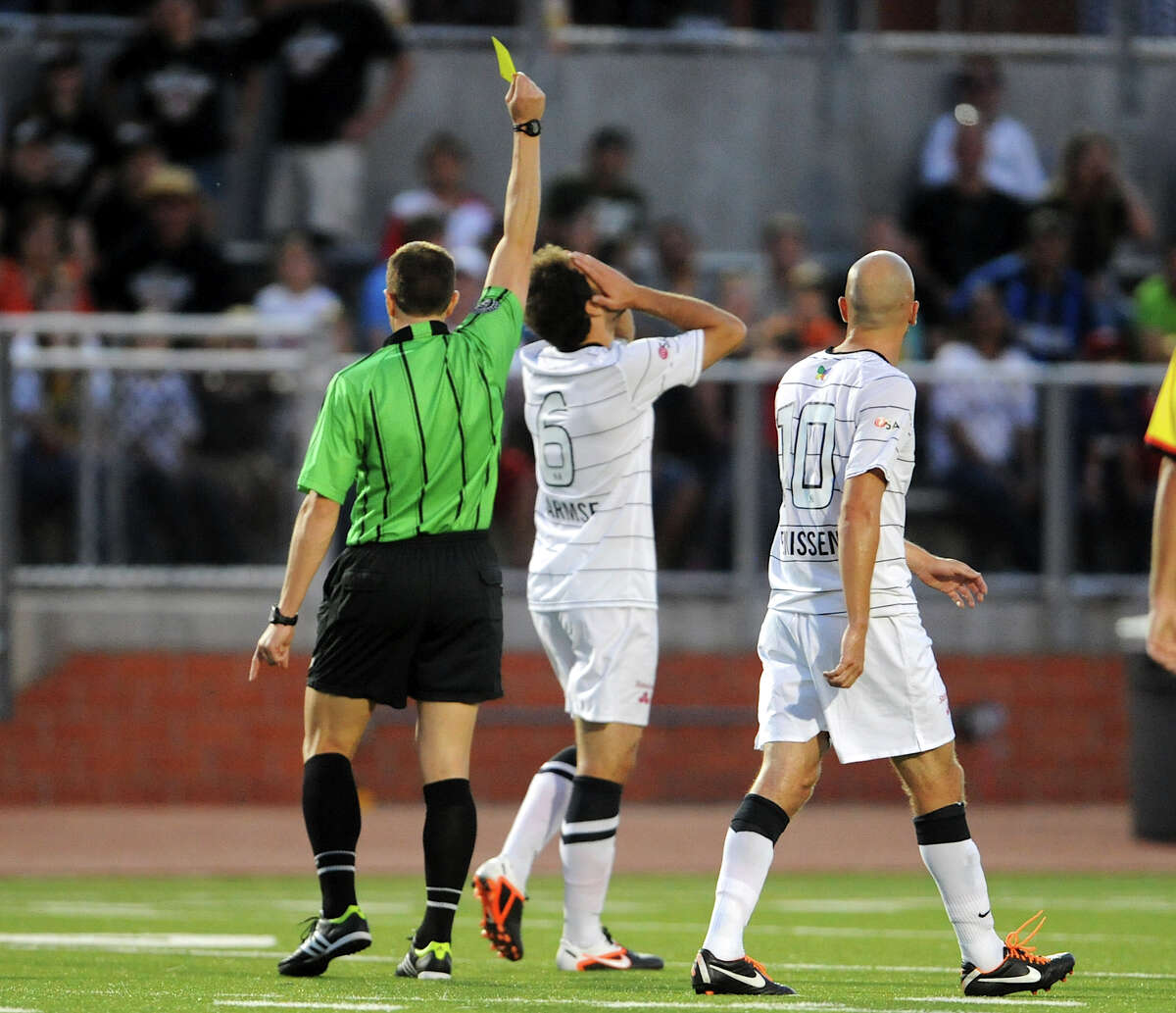 The Scorpions' Kevin Harmse (6) is given a yellow card by the referee during a match against the Fort Lauderdale Strikers on Saturday, April 21, 2012 at Heroes Stadium.