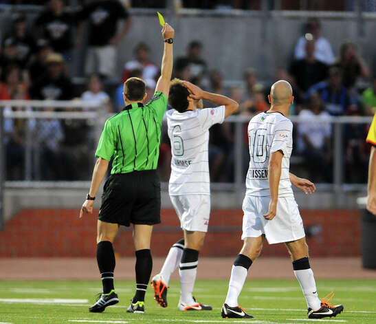 The Scorpions' Kevin Harmse (6) is given a yellow card by the referee during a match against the Fort Lauderdale Strikers on Saturday, April 21, 2012 at Heroes Stadium. Photo: John Albright, For The Express-News