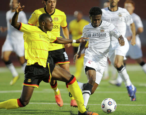 The Scorpions' Walter Ramirez (right) tries to get past Fort Lauderdale's Nickardo Blake (left) during a match on Saturday, April 21, 2012 at Heroes Stadium. Photo: John Albright, For The Express-News
