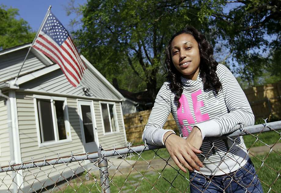 ADVANCE FOR MONDAY, APRIL 9 AND THEREAFTER - In this photo taken March 26, 2012,  Chenae Perkins stands outside a transitional home for female veterans in Nashville, Tenn. After returning from deployment to Iraq with her National Guard unit, Perkins has struggled to find steady work. Once primarily male veteran problems, homelessness and economic struggles are escalating among female veterans, whose numbers have grown during the past decade of U.S. wars while resources for them haven't kept up. The population of female veterans without permanent shelter has more than doubled in the last half-dozen years and may continue climbing now that the Iraq war has ended, sending women home with the same stresses as their male counterparts _ plus some gender-specific ones that make them especially susceptible to homelessness.   (AP Photo/Mark Humphrey) Photo: Mark Humphrey, Associated Press