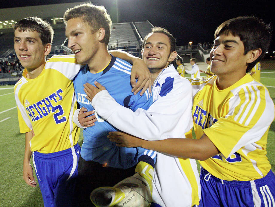 Alamo Heights' Joey Ortega (from left) and teammates Zack Jones, Arturo Espin. and Michael Ellis celebrate their win over Wichita Falls Rider in the Class 4A state final game Saturday April 21, 2012 at Birkelbach Field in Georgetown. Alamo Heights won 3-2 in a shootout. Photo: EDWARD A. ORNELAS, San Antonio Express-News / © SAN ANTONIO EXPRESS-NEWS (NFS)