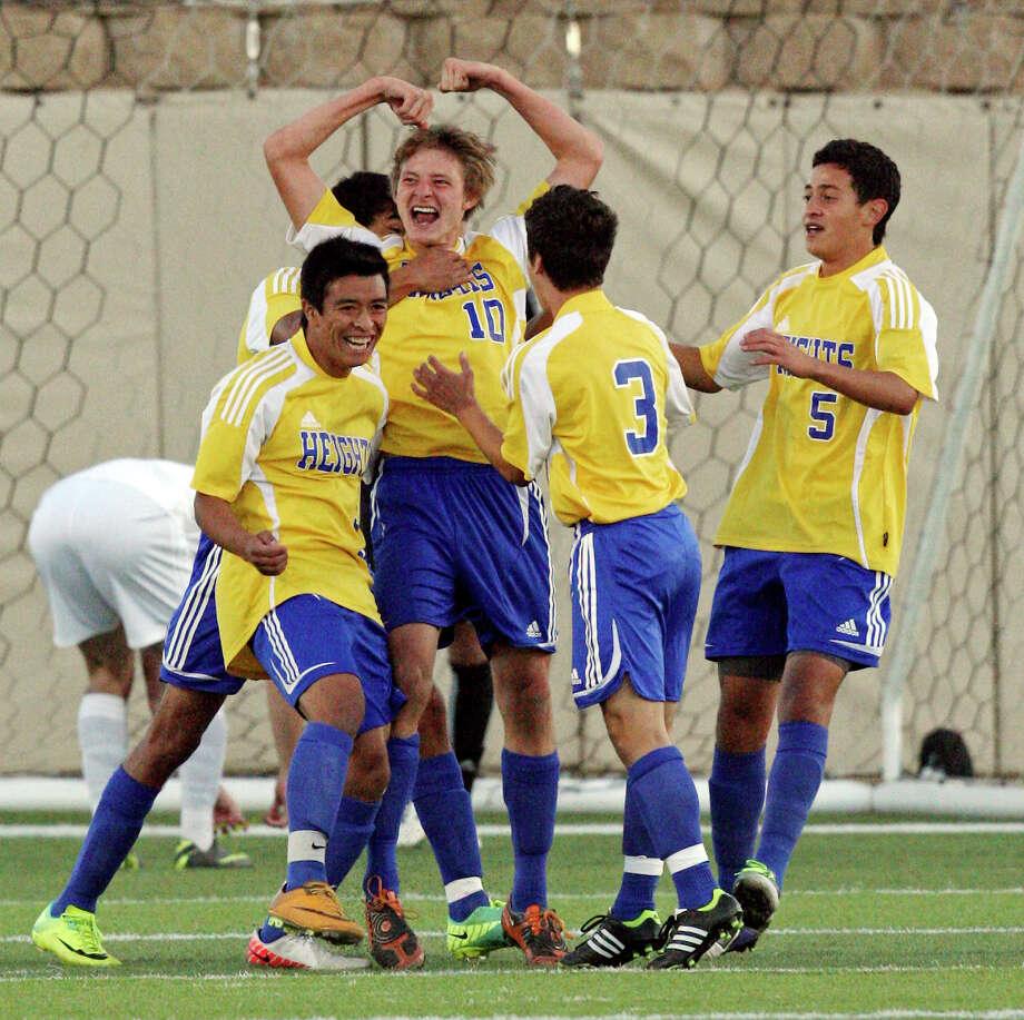 Alamo Heights' Matthew Struble (center) celebrates with teammates after scoring a goal against Wichita Falls Rider during first half action of their Class 4A state final game Saturday, April 21, 2012 at Birkelbach Field in Georgetown. Photo: EDWARD A. ORNELAS, San Antonio Express-News / © SAN ANTONIO EXPRESS-NEWS (NFS)
