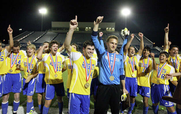 Members of the Alamo Heights Mules soccer team celebrate their 3-2 shootout win over the Wichita Falls Rider Raiders in the Class 4A state final game Saturday, April 21, 2012 at Birkelbach Field in Georgetown. Photo: EDWARD A. ORNELAS, San Antonio Express-News / © SAN ANTONIO EXPRESS-NEWS (NFS)