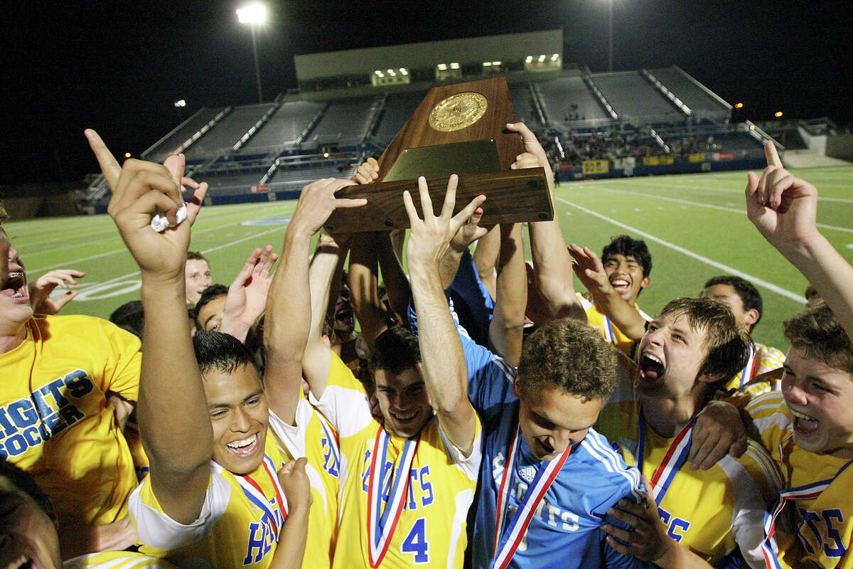 Members of the Alamo Heights Mules soccer team celebrate their 3-2 shootout win over the Wichita Falls Rider Raiders in the Class 4A state final game Saturday, April 21, 2012 at Birkelbach Field in Georgetown.