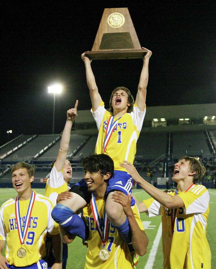 Alamo Heights' Austin Quinn (top) raises the trophy as he is carried by teammate Alamo Heights' Diego Hernandez as others look on after their 3-2 shootout win over Wichita Falls Rider in the Class 4A state final game Saturday, April 21, 2012 at Birkelbach Field in Georgetown. Photo: EDWARD A. ORNELAS, San Antonio Express-News / © SAN ANTONIO EXPRESS-NEWS (NFS)