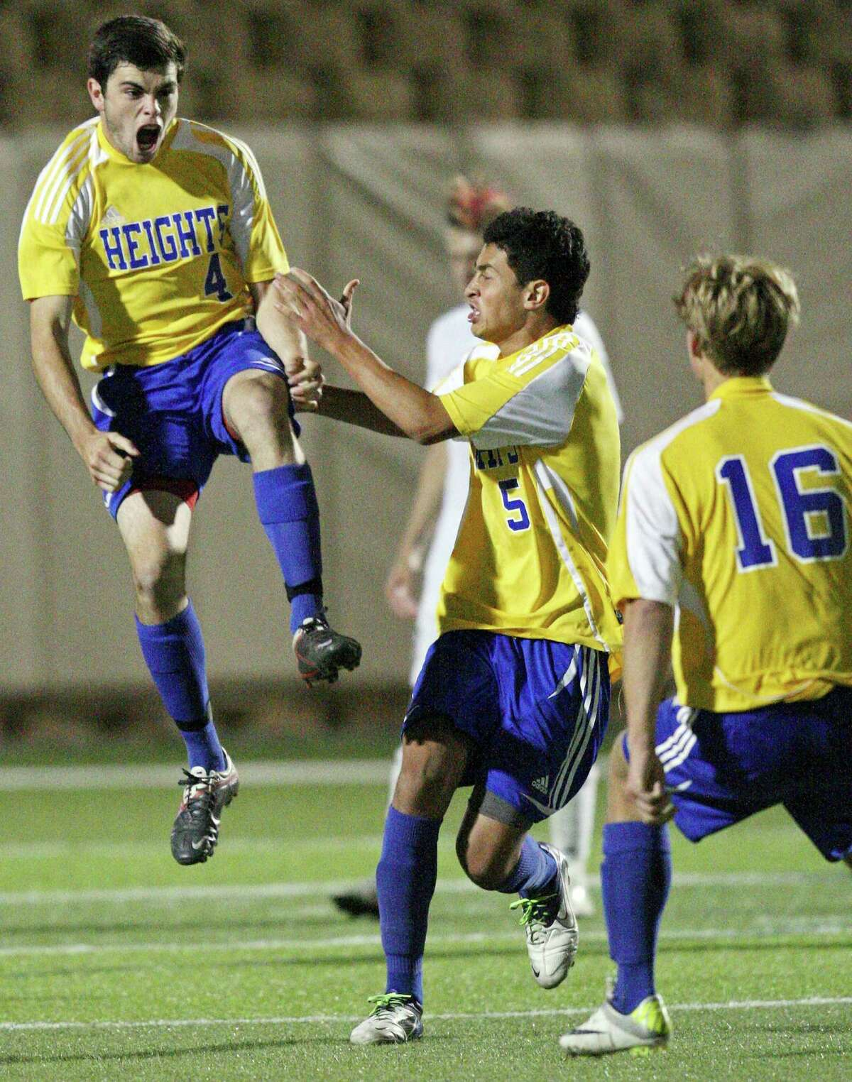Alamo Heights' Alek Strimple (from left) celebrates with teammates Jesus Espin, and Robert Weigel after scoring against Wichita Falls Rider during overtime action of their Class 4A state final game Saturday, April 21, 2012 at Birkelbach Field in Georgetown. Alamo Heights won 3-2 in a shootout.